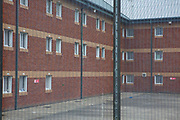 A view through the fence of the exercise yard at YOI Aylesbury, Buckinghamshire, United Kingdom. HMYOI / HM Prison Aylesbury (Her Majesty's Young Offender Institution Aylesbury) is a prison is operated by Her Majesty's Prison Service.