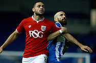 Bristol City defender Derrick Williams and Brighton defender Bruno Saltor grapple during the Sky Bet Championship match between Brighton and Hove Albion and Bristol City at the American Express Community Stadium, Brighton and Hove, England on 20 October 2015. Photo by Bennett Dean.