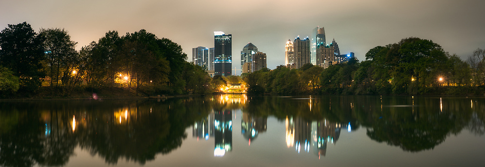 The Atlanta skyline is seen from Piedmont Park at night.