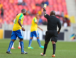 Referee Phillip Thinyani awards a yellow card to Hlompho Kekana of Mamelodi Sundowns during the 1st leg of the MTN8 Semi Final between Chippa United and Mamelodi Sundowns held at the Nelson Mandela Bay Stadium in Port Elizabeth, South Africa on the 11th September 2016<br /><br />Photo by: Richard Huggard / Real Time Images