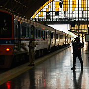 Stained glass window and train on platform at Hua Lamphong station