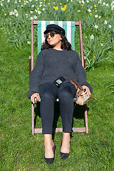 © Licensed to London News Pictures. 05/04/2018. London, UK. A woman relaxes in a deckchair in Green Park in London today. Photo credit: Vickie Flores/LNP