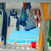 Many colorful towels in a yacht in open sea