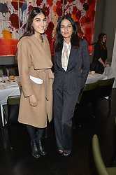 Left to right, LAUREN MILLS and YASMIN MILLS at the mothers2mothers Mother's Day Tea hosted by Nadya Abela at Morton's, Berkeley Square, London on 12th March 2015.  mothers2mothers is a charity working to eliminate mother to child transmission of HIV/AIDS across sub-Saharan Africa.