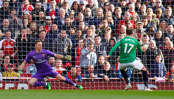 Brighton & Hove Albion's Glenn Murray scores his side's first goal of the game from the penlaty spot during the Premier League match at the Emirates Stadium, London.