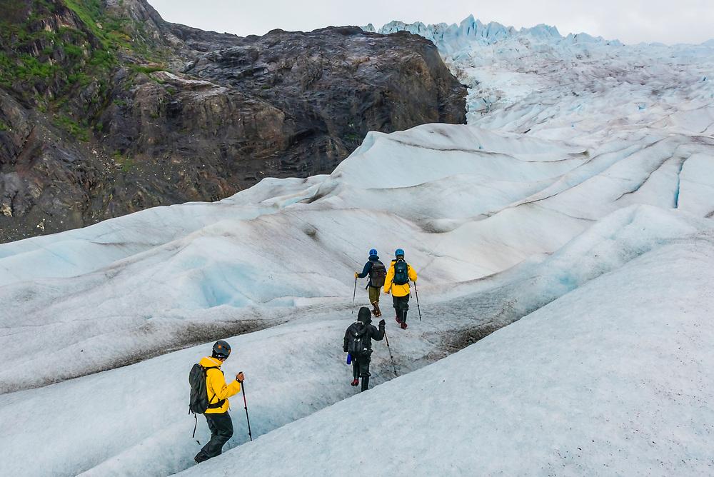 Walking on the Mendenhall Glacier (with ice crampons) on a Glacier tour with Above & Beyond Alaska, Juneau, Alaska USA.