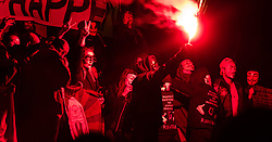 London, November 05 2017. Anti-capitalists gather in Trafalgar Square, London for the annual 'Million Mask March' which happens on November 5th every year, with many of the protesters donning 'V' For Vendetta Guy Fawkes masks. Past marches have turned violent with police horses shot by fireworks and police vehicles burned. PICTURED: Protesters light flares in Trafalgar Square. © Paul Davey