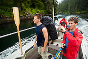 Henry (left) and Zach Podell-Eberhardt ride the ferry across the Nitinat Narrows, West Coast Trail, British Columbia, Canada.