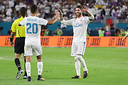 Real Madrid Midfielder Marco Asensio is congratulated by Real Madrid Defender Sergio Ramos after his goal 2-2 during the International Champions Cup match between Real Madrid and FC Barcelona at the Hard Rock Stadium, Miami on 29 July 2017.