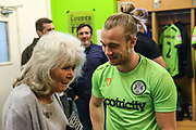 Forest Green Rovers Joseph Mills(23) chats with Jilly Cooper during the EFL Sky Bet League 2 match between Forest Green Rovers and Milton Keynes Dons at the New Lawn, Forest Green, United Kingdom on 30 March 2019.