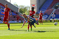 Michael Jacobs of Wigan Athletic looks for a penalty as he is tackled by Bruno Ecuele Manga of Cardiff City. EFL Skybet Championship match , Wigan Athletic v Cardiff city at the DW Stadium in Wigan, Lancs on Saturday 22nd April 2017.<br /> pic by Chris Stading, Andrew Orchard sports photography.