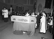Funeral Of Frank Duff.   (N50)..1980..13.11.1980..11.13.1980..13th November 1980..The Solemn Funeral Mass for Frank Duff, founder of The Legion of Mary,was concelebrated with his Eminence,Cardinal Tómas O'Fiaich,Archbishop of Armagh and Primate of All Ireland as principal celebrant, at St Andrew's Church, Westland Row,Dublin. The funeral took place after the mass to Glasnevin Cemetery..Cardinal O'Fiaich descends from the altar to bless the coffin prior to the removal to Glasnevin Cemetery.