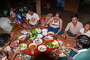 Family meal in rural Thailand the family is sitting on a mat on the floor