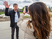 20 MAY 2019 - DAVENPORT, IOWA: BETO O'ROURKE talks a peope via a cell phone video call during a tour of flood damage in Davenport. O'Rourke, running to be the 2020 Democratic nominee for the US Presidency, has made climate change a central part of his campaign. He toured flood damage in Davenport Monday. The Mississippi River flooded through downtown Davenport on April 30 and much of downtown is still recovering from the flood.       PHOTO BY JACK KURTZ