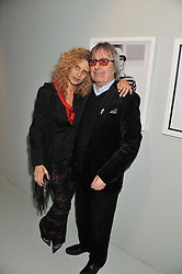 BILL & SUZANNE WYMAN at a private view of Bill Wyman - Reworked held at the Rook & Raven Gallery, 7 Rathbone Place, London W1 on 26th February 2013.