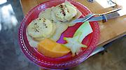 Eggs Benedict with starfruit and papaya