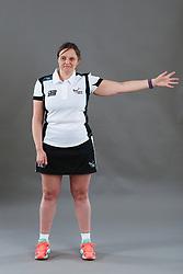 Umpire Rachael Radford signalling direction of pass