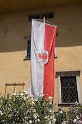 The flag of the autominous and prosperous South Tyrol region (province) of north Italy. The South Tyrolean budget is 5bn Euros with only 10% leaving the region for government in Rome.