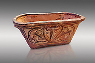 Minoan  pottery bath tub larnax decorated with a stylised crocus flower ,  Episkopi-Lerapetra 1350-1250 BC, Heraklion Archaeological  Museum, grey background.<br /> <br /> To the Greeks, the Underworld was entered by water. As with many other Minoan bathtubs, this one was probably later used as a coffin to convey the deceased across the sea, where marine imagery would be equally appropriate. The two functions of bathtubs, bathing and burial, combine in the story of Agamemnon who, on return from Troy, was murdered by his wife and her lover in a silver bath. .<br /> <br /> If you prefer to buy from our ALAMY PHOTO LIBRARY  Collection visit : https://www.alamy.com/portfolio/paul-williams-funkystock/minoan-art-artefacts.html . Type -   Heraklion   - into the LOWER SEARCH WITHIN GALLERY box. Refine search by adding background colour, place, museum etc<br /> <br /> Visit our MINOAN ART PHOTO COLLECTIONS for more photos to download  as wall art prints https://funkystock.photoshelter.com/gallery-collection/Ancient-Minoans-Art-Artefacts-Antiquities-Historic-Places-Pictures-Images-of/C0000ricT2SU_M9w