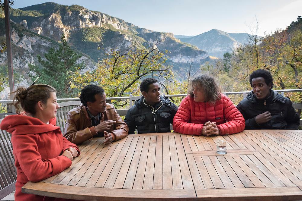 November 9, 2016 - Breil-sur-Roya, France: Alain (2R) and Camille (L), are farmers who house three Eritrean migrants, Tedros (2L), 28, Michiele (C), 21, and Hermon (R), 22, picked up by a network member as they were walking on the road. 120 inhabitants of the village Breil-sur-Roya in the Roya valley, in the Alps on the French Italian border, formed a clandestine network to help migrants who walked into the valley from Ventimiglia, Italy, with shelter, food and transportation.<br /> <br /> 9 novembre 2016 - Breil-sur-Roya, France: Alain (2D) et Camille (G), sont agriculteurs qui hébergent trois migrants érythréens, Tedros (2G), 28, Michiele (C), 21 et Hermon (D) , 22, trouvés par un membre du réseau alors qu'ils se promenaient sur la route. 120 habitants du village de Breil-sur-Roya, dans la vallée de la Roya, dans les Alpes, à la frontière entre la France et l'Italie, ont formé un réseau pour venir en aide aux migrants qui venaient de Ventimiglia en Italie.