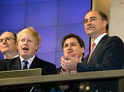 © London News Pictures. 12/02/2013 . London, UK. Mayor Of London, BORIS JOHNSON (left) opening the days trading at the London Stock Exchange with XAVIER ROLET, CEO of London Stock Exchange Group (right).  Photo credit : Ben Cawthra/LNP