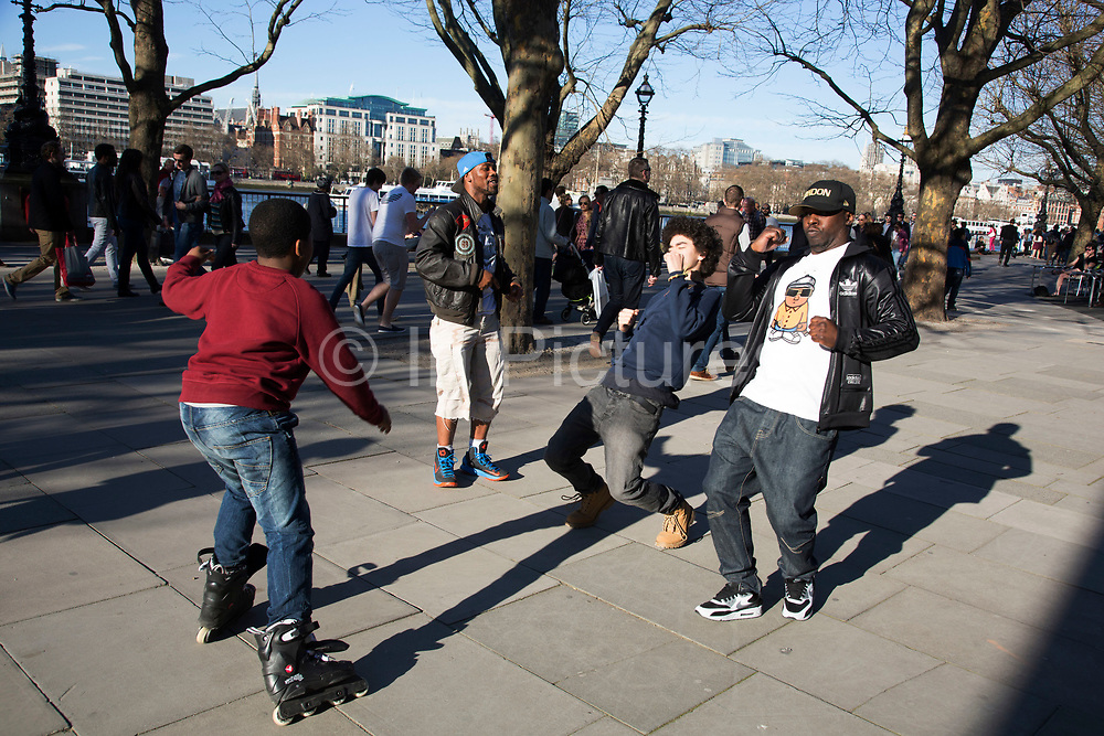 Rap video shoot for the hip hop artist Geebag. Various other friends provide the supporting cast to the video as Geebag performs in slow motion, designed to look like everyone around is moving fast. The South Bank is a significant arts and entertainment district, and home to an endless list of activities for Londoners, visitors and tourists alike.