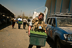 A man carries a box at the site of the explosion at the Canal Hotel for bodies in Baghdad, Iraq on Aug. 21, 2003. Earlier in the week a cement truck packed with explosives detonated outside the offices of the UN headquarters in Baghdad, Iraq, killing 20 people and devastating the facility in an unprecedented suicide attack against the world body. At least 100 people were wounded.