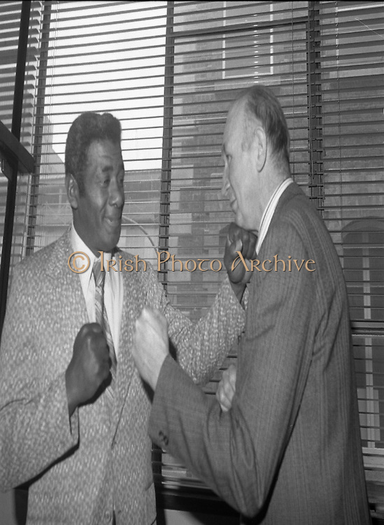 Fisticuffs at Guinness..1980-04-09.9th April 1980.09-04-1980.04-09-80..Photographed at Guinness, St James's Gate Brewery, Dublin...Floyd Patterson, twice heavyweight boxing champion of the world, and now a commissioner of the New York State Athletic Commission on a visit to Guinness. He is accompanied by Justin Collins, the Visits Manager for Guinness...