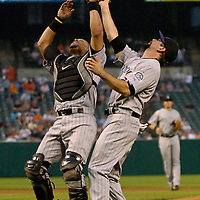 08 June 2007:  Colorado Rockies catcher Yorvit Torrealba (L) and first baseman Todd Helton (17) nearly collide as Helton catches an infield fly in the 4th inning off the bat of Baltimore Orioles left fielder Jay Gibbons.  The Orioles defeated the Rockies 4-2 in interleague play at Camden Yards in Baltimore, MD.   ****For Editorial Use Only****