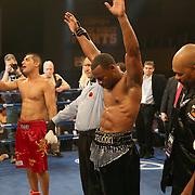 "Brandon Adams (black shorts) beats Raymond Gartica (red shorts) after a split decision during the ESPN ""Boxcino"" boxing tournament at Turning Stone Resort Casino on Friday, April 18, 2014 in Verona, New York.  (AP Photo/Alex Menendez)"