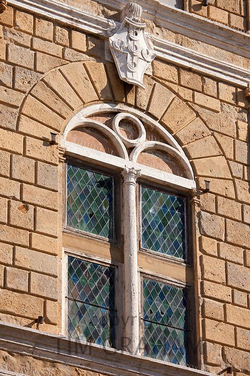 Stained glass leaded light window of Palazzo Piccolomini in Via Del Balzello, in Pienza, Tuscany, Italy