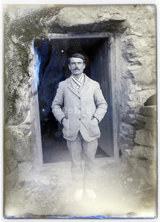 portrait of adult man in front of door opening early 1900s