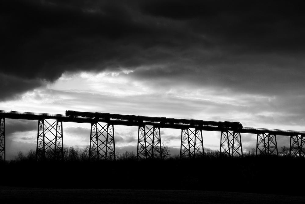 Crossing Moodna Viaduct under threatening skies, this westbound train heads towards Port Jervis.