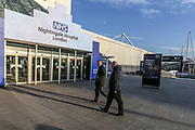 After the British Government announced on Tuesday, that the ExCel Center in east London will become a 4,000-bed temporary hospital to deal with future coronavirus patients. The entry of the NHS Nightingale Hospital is seen lit on Thursday, March 26, 2020. (Photo/Vudi Xhymshiti)