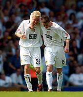 Fotball<br /> Leeds United v Derby County<br /> Coca Cola Championship<br /> 07/08/2004<br /> Foto: SBI/Digitalsport<br /> NORWAY ONLY<br /> <br /> Leeds' Frazer Richardson (R) is congratulated by Matthew Kilgallon after scoring.