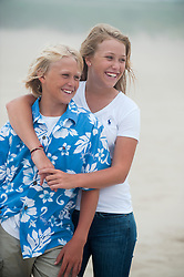 adorable blonde brother and sister at the beach in East Hampton, NY