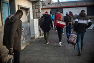 African migrants who arrived by bus to Irun follow some volunteer from the host network who guide them to the Red Cross center. Irun (Basque Country). December 18, 2020. A group of volunteers has created a host network to serve migrants and inform about the public services they are entitled to and the ways to cross the border. This group of volunteers is avoiding a serious humanitarian problem Irun, the Basque municipality on the border with Hendaye. As the number of migrants arriving on the coasts of southern Spain incresead, more and more migrants are heading north to the border city of Irun. One of the functions performed by these volunteers is to direct the newcomers to the device the red cross has for migrants in transit, so that they can sleep in a safe place. (Gari Garaialde / Bostok Photo).