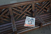 A cop of the Evening Standard with the headline about Kevin Spaceys alleged sexual abuse and announcement of being gay, lies on a bench, on 30th October 2017, in the City of London, England.