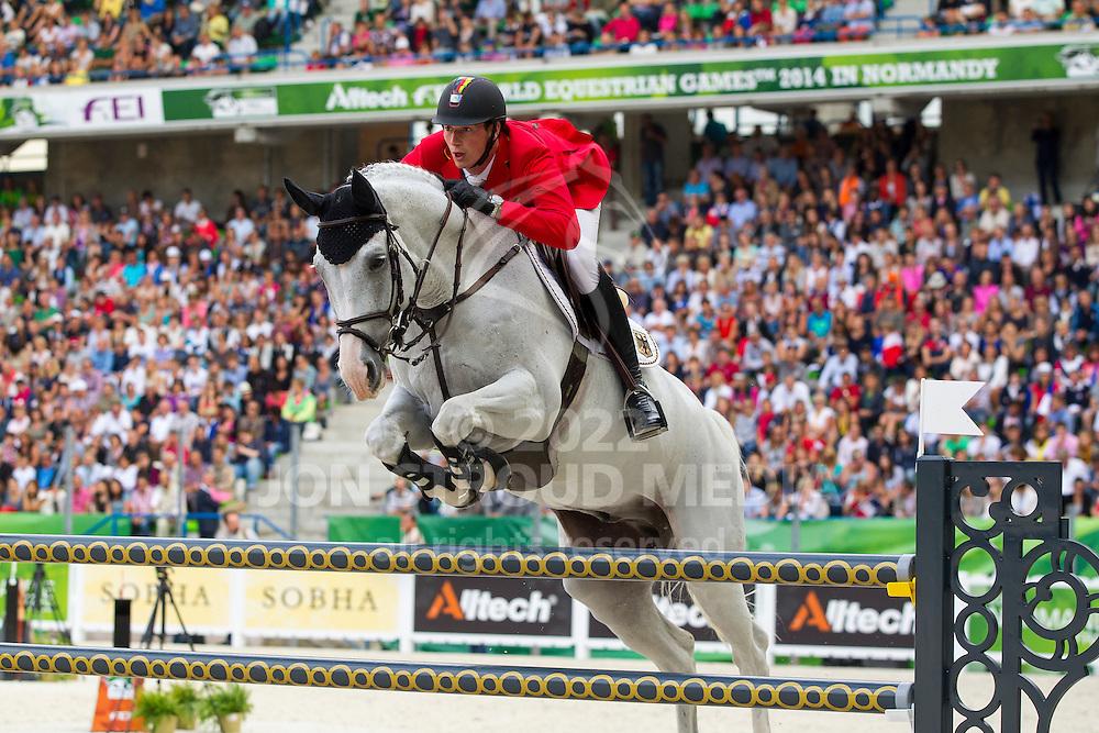 Daniel Deusser, (GER), Cornet D Amour - World Champions, - Second Round Team Competition - Alltech FEI World Equestrian Games™ 2014 - Normandy, France.<br /> © Hippo Foto Team - Leanjo De Koster<br /> 25/06/14