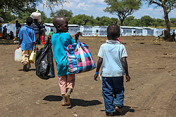 There are around 80,000 children in BidiBidi settlement and due to lack of resources, currently only 23,000 are getting an education in makeshift schools. More than 300,000 South Sudanese refugees have fled from the country's civil war into Uganda since fighting broke out in July. They mostly travel by foot for days through the bush as roads have been blocked or are too dangerous to cross. The massive influx of refugees has caused a strain in humanitarian aid due to large numbers and lack of funding. BidiBidi settlement is now the third largest in the world and holds more than 210,000 people since its opening in September.