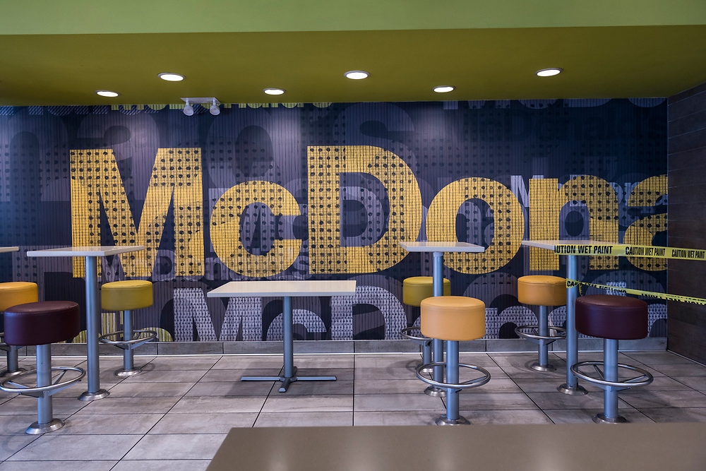New York City, USA - March 21, 2020: An empty McDonald's restaurant seating area in the Washington Heights neighborhood of Manhattan. The fast-food chain was open for take-out, but as with other restaurants in the city, dine-in was not allowed.