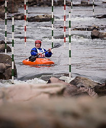 John Tansil of Cape Girardeau, Missouri races in the K1 men's short plastic class during the slalom course of the 42nd Annual Missouri Whitewater Championships. Tansil placed third place in the class. The Missouri Whitewater Championships, held on the St. Francis River at the Millstream Gardens Conservation Area, is the oldest regional slalom race in the United States.