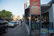 A view of businessess and people, including backpackers, early on a Saturday evening at Mitchell Street in downtown Darwin, Australia.