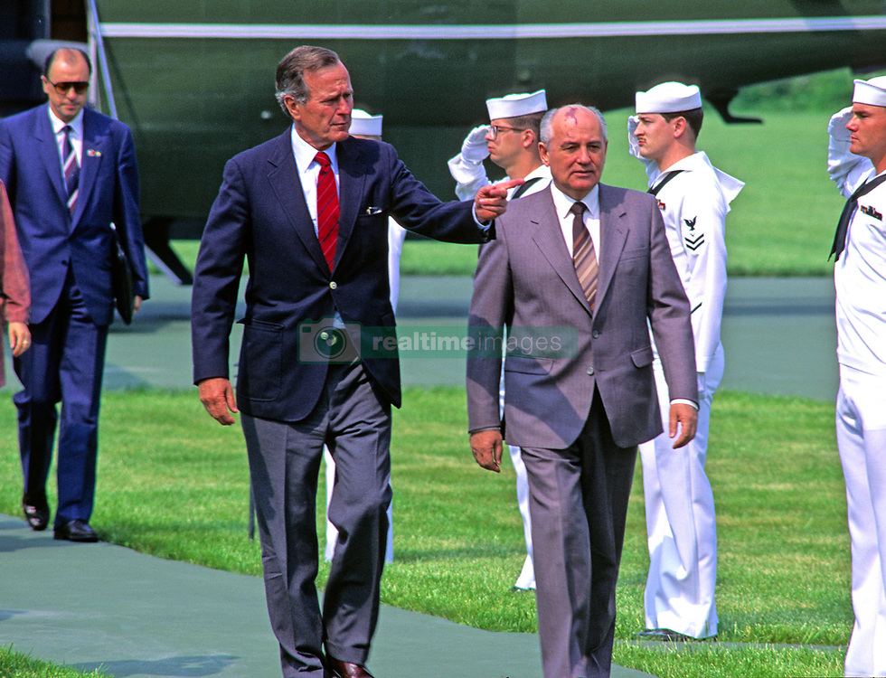 United States President George H.W. Bush, left, and President Mikhail Gorbachev of the Union of Soviet Socialist Republics, right, in conversation as they arrive for day of talks at Camp David, the presidential retreat near Thurmont, Maryland on Saturday, June 2, 1990. From left to right, President Bush, first lady Barbara Bush, Raisa Gorbachev, unidentified interpreter, and President Gorbachev. Photo by Ron Sachs / CNP /ABACAPRESS.COM