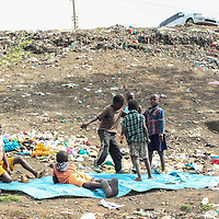 Young boys playing on a dumping site by the river