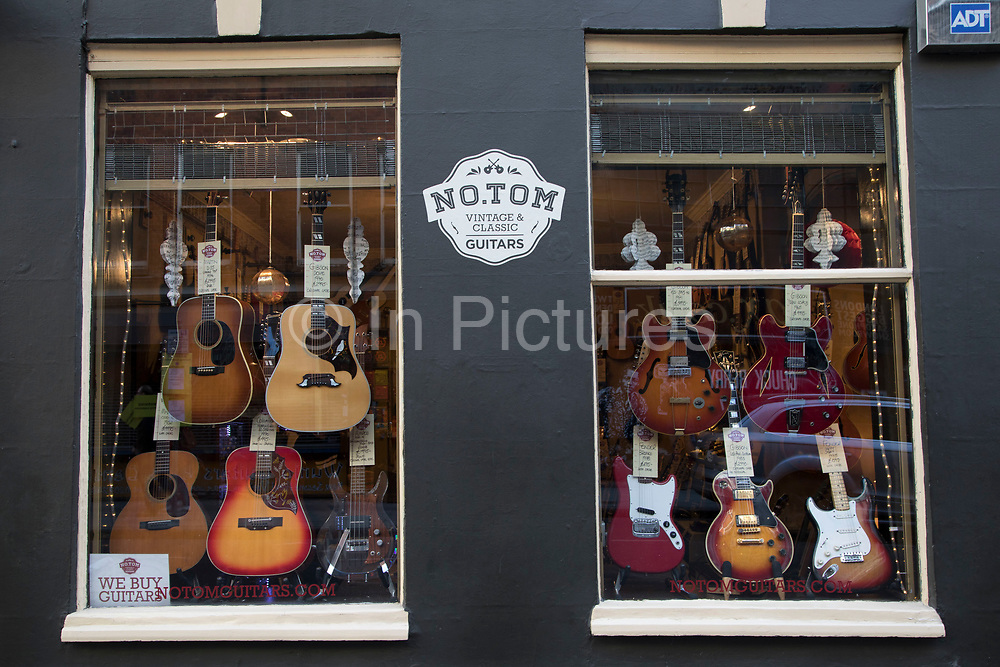 Music and guiltar shop on Denmark Street, London, United Kingdom. Also known as Tin Pan Alley, this is the most famous place for musical instruments in the city.
