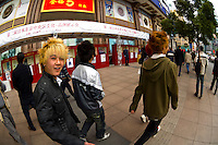 Young Chinese men strolling down Nanjing Road, Shanghai, China