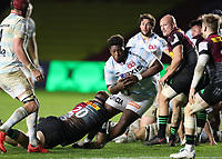 Georges-Henri Colombe of Racing 92 is tackled by James Chisholm of Harlequins