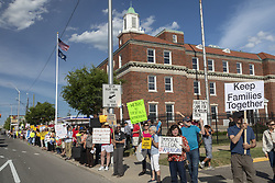 June 14, 2018 - Detroit, Michigan, U.S. - Protesters oppose the Trump administration's policy of separating young children from their parents at the U.S.-Mexico border. Lining the street outside the Immigration and Customs Enforcement detention center, the group was part of nationwide protests in many cities organized by Families Belong Together. (Credit Image: © Jim West via ZUMA Wire)