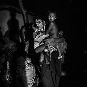 Rohingya refugees crossing the Bangladeshi border walk at night to the UNHCR transit camp. Since the end of august 2017, the beginning of the crisis, more than 600,000 Rohingyas have fled Myanmar to seek refuge in Bangladesh. Cox's Bazar - november the 2nd 2017.<br /> Des réfugiés Rohingyas ayant franchi la frontière bangladaise marchent de nuit pour rejoindre le camp de transit du UNHCR. Depuis le début de la crise, fin août 2017, plus de 600000 Rohingyas ont fuit la Birmanie pour trouver refuge au Bangladesh. Cox's Bazar le 02 novembre 2017.